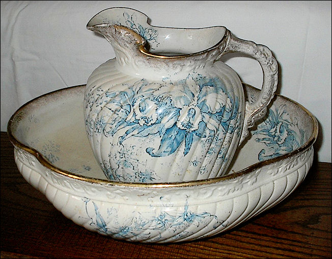 "A Whittaker and Heath wash set jug and basin in the  ""Florian"" pattern"