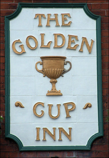 Golden Cup sign in tiles