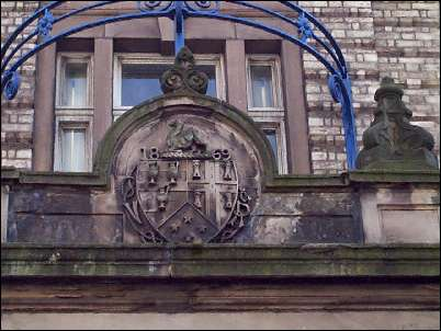Detail of crest above the town hall door.